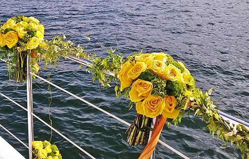 Yellow Roses decorating yacht for sea burial